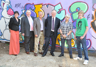 Meeting members of the Vison Youth Cafe in front of their legal graffiti wall