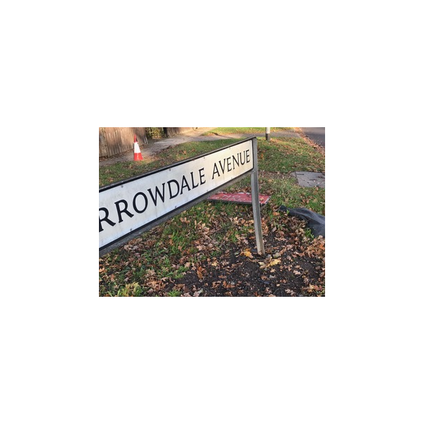Barrowdale Avenue street sign with abandoned roadworks items